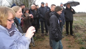 Crowd gathers to watch the water flowing into the new nature reserve at Besthorpe.